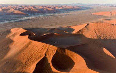 Aerial view of high red dunes, located in the Namib Desert, in the Namib-Naukluft National Park of Namibia, Africa