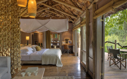 Bedroom at Lake Manyara Tree Lodge in Lake Manyara & Ngorongoro, Tanzania - best luxury vacation spots in the world
