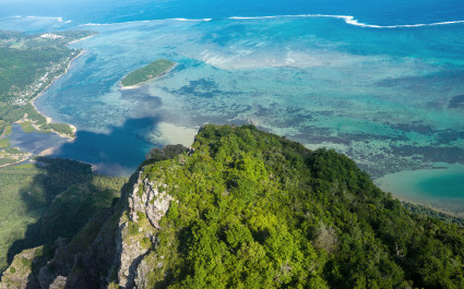 Pictured at the top of Le Morne Brabant Mountain is a blue pool, Mauritius