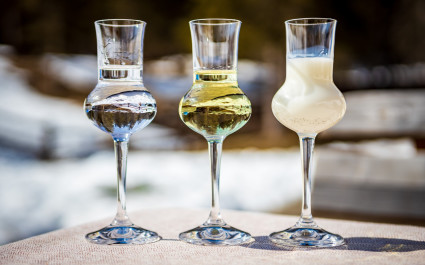 Enchanting Travels Italy Tours Detail of three flavored Grappa (Schnapps) glasses in Cortina d'Ampezzo, Dolomites, Italy