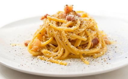 Enchanting Travels Italy Tours Dish of Spaghetti alla Carbonara, typical italian recipe of pasta with guanciale, egg ad pecorino romano cheese
