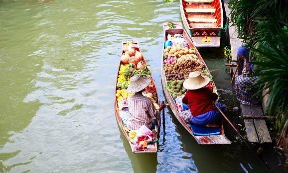 two-vendors-on-damnoen-saduak-floating-market-near-bangkok-in-thailand-shutterstock_60357331