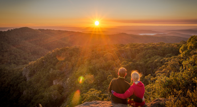 A-young-couple-enjoying-the-beautiful-sunrise-on-Mount-Kaputar-in-New-South-Wales-Australia