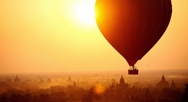 Silhouette of hot air balloon over Bagan in Myanmar, tourists watching sunrise over ancient city, shutterstock_134373722