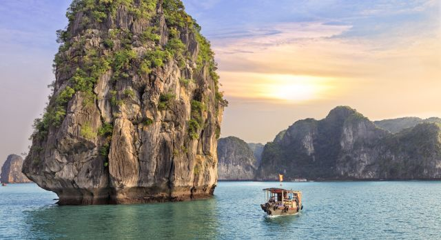 Dreamy sunset among the rocks of Halong Bay, Vietnam Asia - Ideal for winter travel