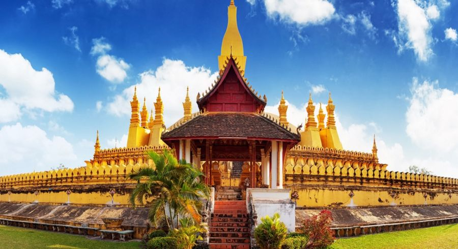 Enchanting Travels Laos Tours golden pagoda wat Phra That Luang in Vientiane.