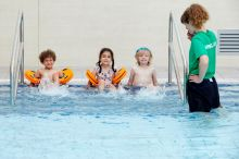 Children enjoying pre school swimming lessons