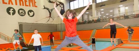 Boy jumping on trampolines at our Trampoline Parks