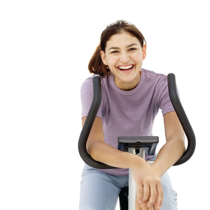 Facebook-Adult_female_laughing_on_exercise_bike.jpg