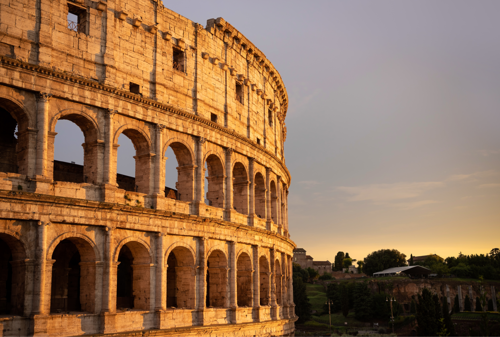sunset over colosseum in rome italy
