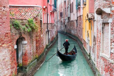 Gondola Ride on a Canal in Venice Italy