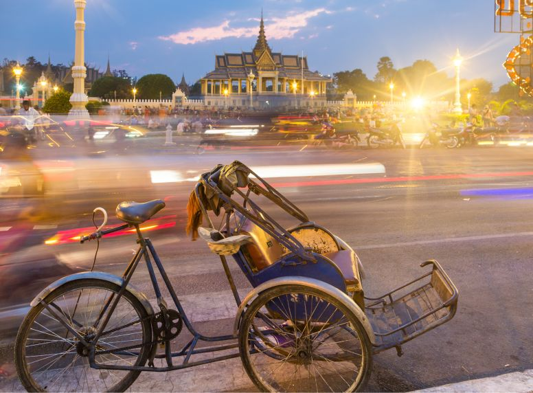 Bike on Street in Front of Temple at Phnom Penh during Evening