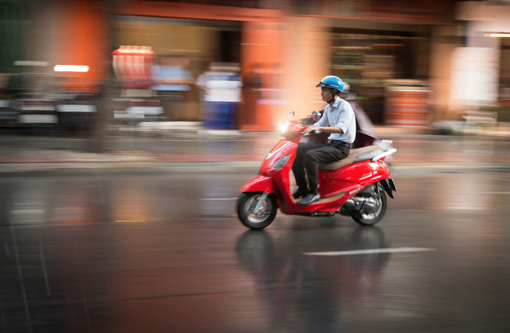 Does my medical insurance cover me while I'm riding my scooter in Vietnam?