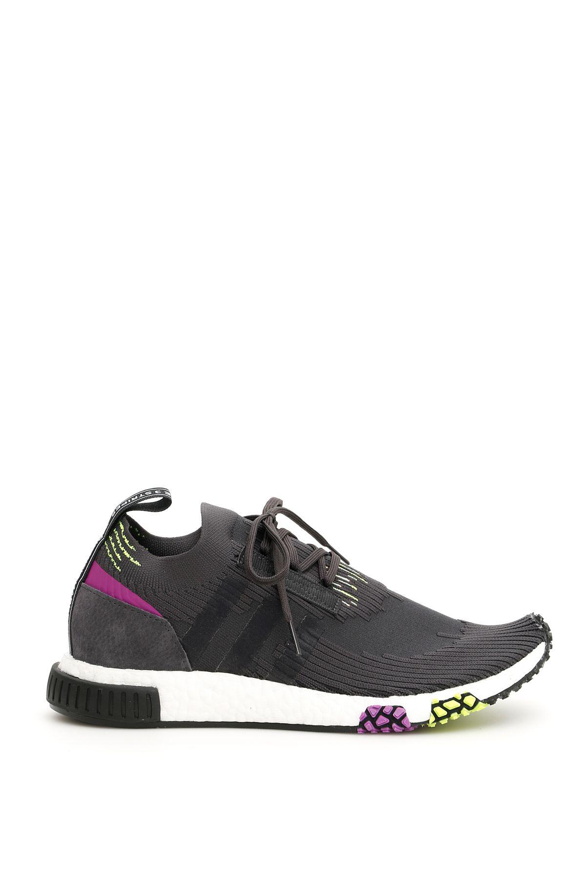 f84c823510ef ADIDAS ORIGINALS. Adidas Nmd Racer Sneakers in Carbon Core Black Solar  Yellow