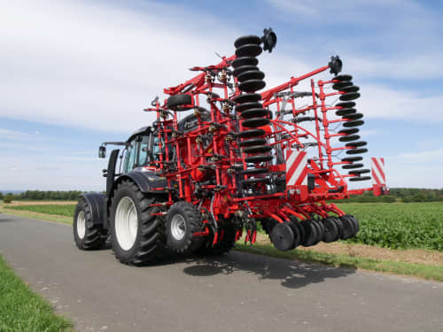 Kverneland ts-drill, transported compact on road by tractor