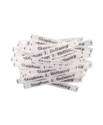 Étiquettes á clipser tissées