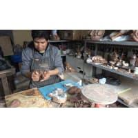 Richard Chavez, Peruvian master ceramist, creating a Nativity