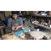 Richard Chavez, Peruvian master ceramist, creating a Nativity