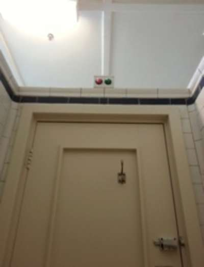 Division bells above a toilet door