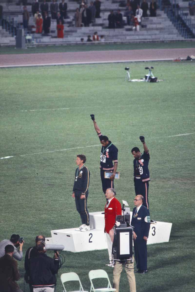This famous photo shows Peter Norman standing silently as his two American friends give a salute for civil rights. Norman, a devout Christian, believed it was his duty to support his colleagues in their struggle. Getty Images.