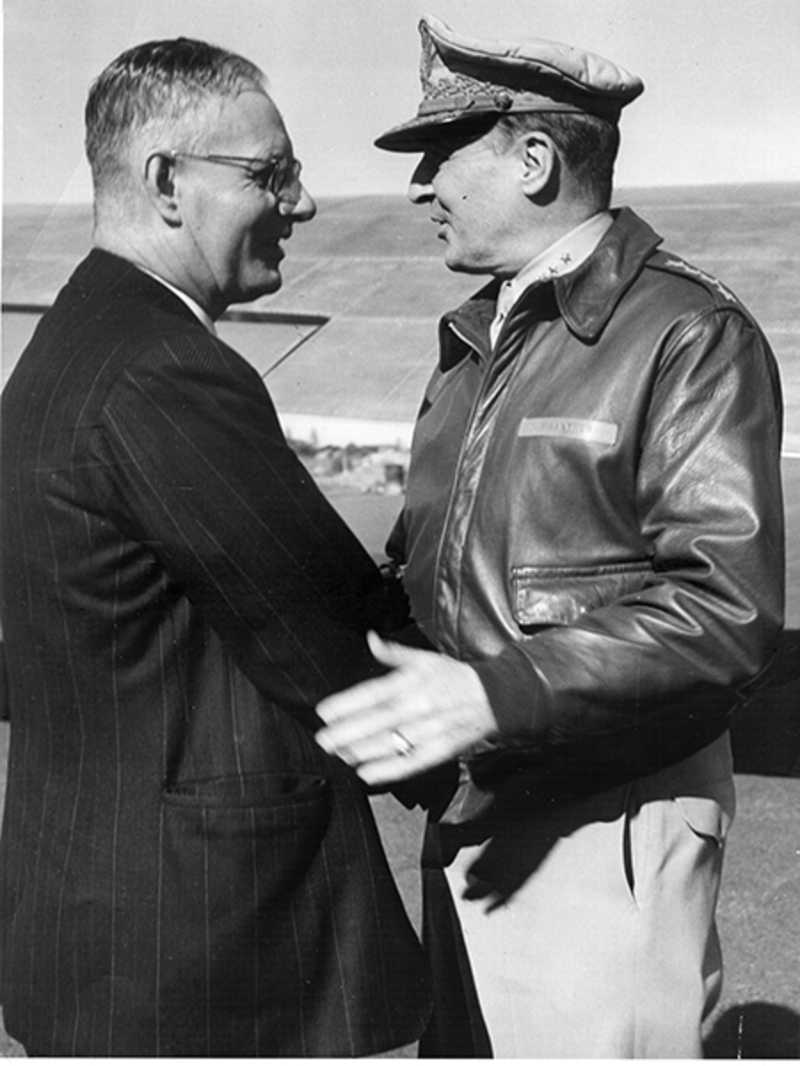 Curtin shakes hands with MacArthur, 1943. This photo doesn't depict their first meeting or handshake, but the friendly relationship between them, which shaped Australia's place in World War II, is still evident. John Curtin Prime Ministerial Library.