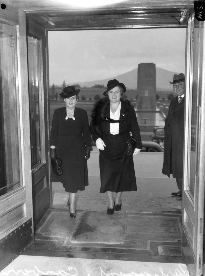 Dorothy Tangney and Enid Lyons walk through the front door of Old Parliament House together in 1943.