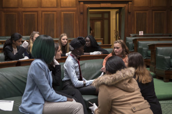 Some of the 2019 'Girls Takeover Parliament' team making big plans in our House of Representatives Chamber.  Photographer: Bec Selleck.