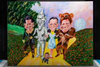 This painting by Mark Tippett depicts the politically-diverse Senate crossbench after the 2016 election. Both Jacquie Lambie and Pauline Hanson (shown here as Dorothy and the Lion from the Wizard of Oz) managed to have key roles in the senate balance of power, a position neither would have been in if they'd stayed in their original party. The painting also shows Nick Xenophon (the Scarecrow), Greens leader Richard di Natale (Tin Man) and Derryn Hinch (Toto), with Prime Minister Malcolm Turnbull in the background.