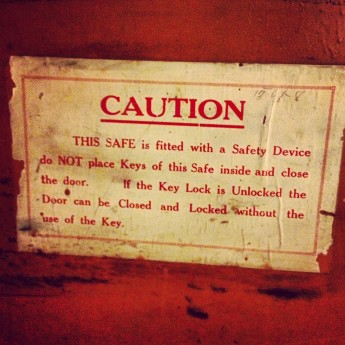A word of caution on the inside of the smaller door