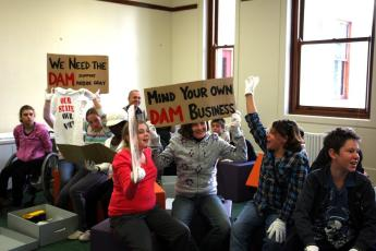 Students interrogating protest material in the Franklin River Debate: 1983 program.