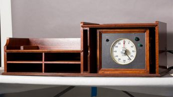 This blackwood timer, manufactured by Beard Watson & Co Ltd, is still located in the House of Representatives Chamber where it was used in the Provisional Parliament House between 1927 and 1988. When Parliament was in session this timer was controlled by the Clerk to assist in timing the speeches of Members.