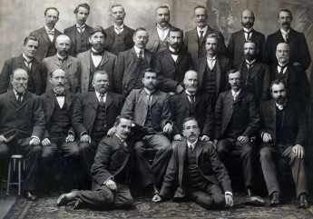 Group photograph of all Federal Labour Party MPs elected at the inaugural 1901 election, including Watson, Andrew Fisher, Billy Hughes, and Frank Tudor.