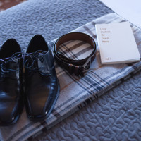 Dress shoes, belt and book