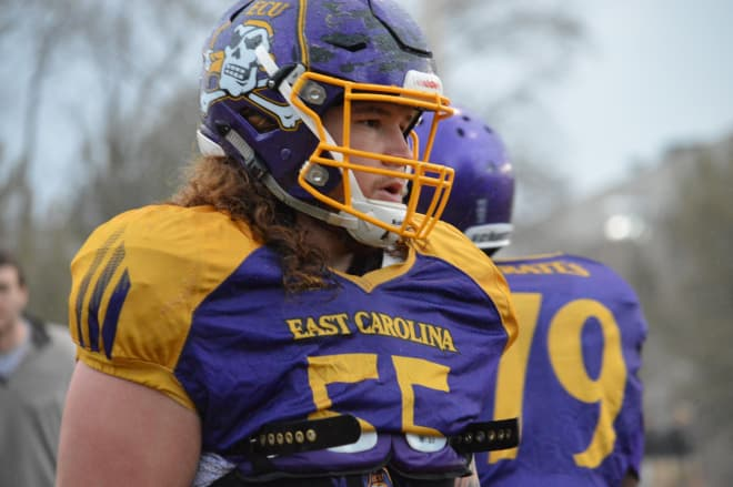 ECU senior Garrett McGhin who can play a multitude of positions is pictured going through a wet Monday workout.