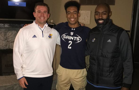 Cramer (left) and Jackson (far right) met with Russell for an in-home visit