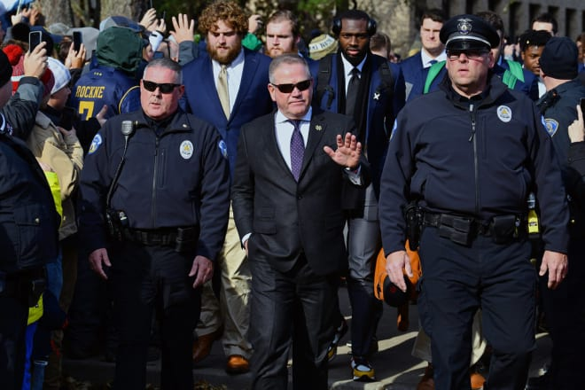 Brian Kelly walking into Notre Dame Stadium before his team's matchup with Navy (Photos by Andris Visocks)