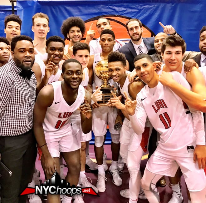 The Long Island Lutheran Crusaders hold up the 2018 SNY Invitational championship trophy