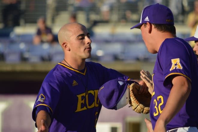 ECU Saturday starter Jake Kuchmaner receives congratulations after leaving the game in the ninth inning.
