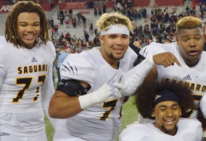 Saguaro offensive linemen celebrate after taking the 4A championship game in Tucson last November over Salpointe.  Photo by Ralph Amsden