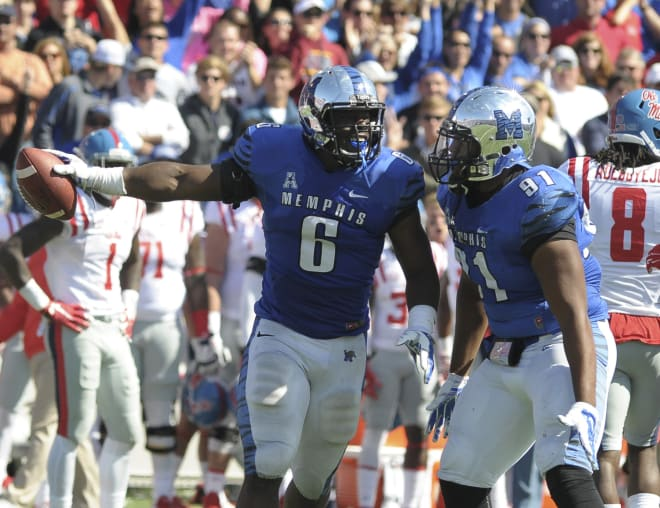 Memphis linebacker Genard Avery celebrates a big play during the Tigers' 37-24 win over Ole Miss last October. Avery, a Grenada, Miss., product, said Monday he's hoping to transfer to Ole Miss.