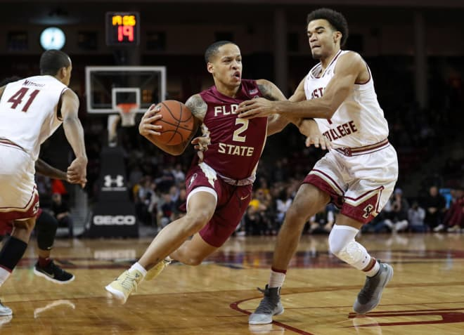 Sophomore guard C.J. Walker drives Monday night at Boston College.
