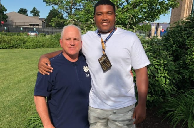 Blake Fisher with Notre Dame OL coach Jeff Quinn during a campus visit