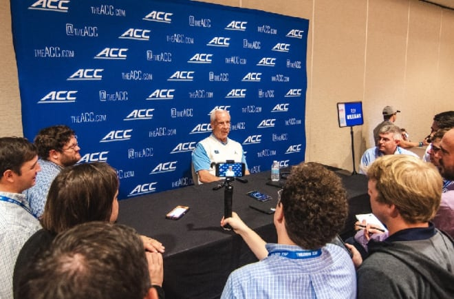 Roy Williams, Brandon Robinson and Garrison Brooks takes questions from the media during their breakout sessions Tuesday.