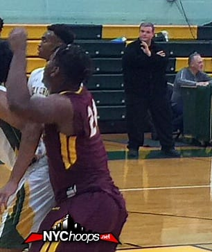 Christ the King battles on the boards as Coach Cox looks on intently