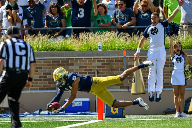 Notre Dame freshman safety Kyle Hamilton, seen here scoring a touchdown in his first career game at Notre Dame Stadium, is living up to his recruiting hype.