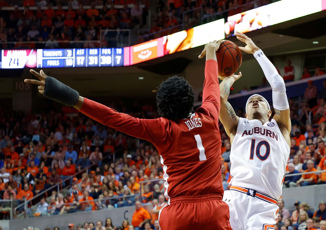 Alabama junior Herb Jones blocks a shot late in the second half against No. 11 Auburn on Wednesday night. (Photo by Kevin C. Cox/Getty Images)