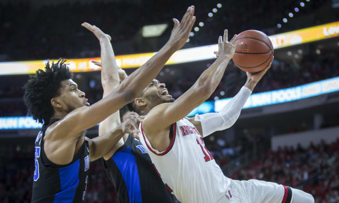 NCSU fifth-year senior guard Allerik Freeman drives for an off-balance, left-handed shot.