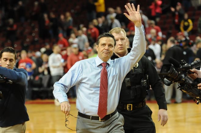 Head coach Tim Miles waves to the fans after Nebraska's 93-91 overtime win over Iowa to close out the regular season.
