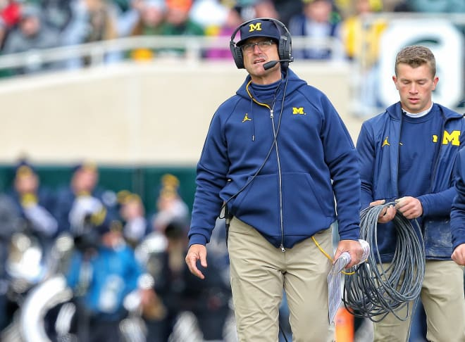 Michigan head coach Jim Harbaugh and his team fell to 2-1 after a loss to Wisconsin Saturday.