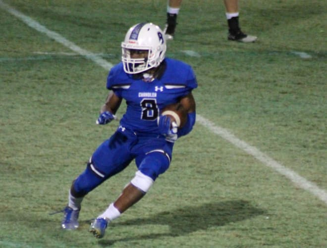 Chandler linebacker Jaheim Brown-Taylor makes a move during the Wolves' semfinal playoff game last season.  He rushed for 755 yards as a junior for CHS.